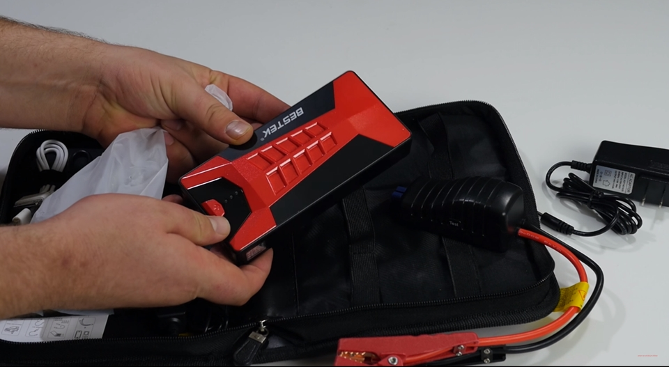 A portable jump starter kit with A/C adapter